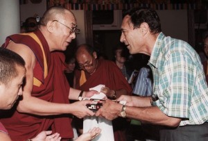 Mack presents the Dalai Lama with a copy of his book Abduction: Human Encounters with Aliens in 1999 (C) - by Carl Studna